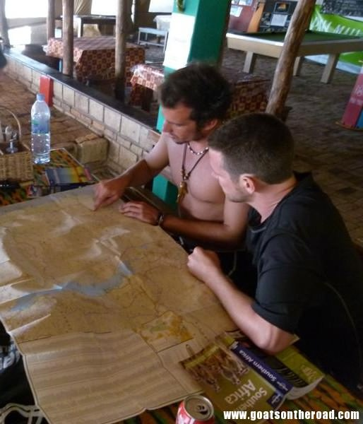 with our new friend trying to map out our next 3.5 weeks together, Tofo, Mozambique
