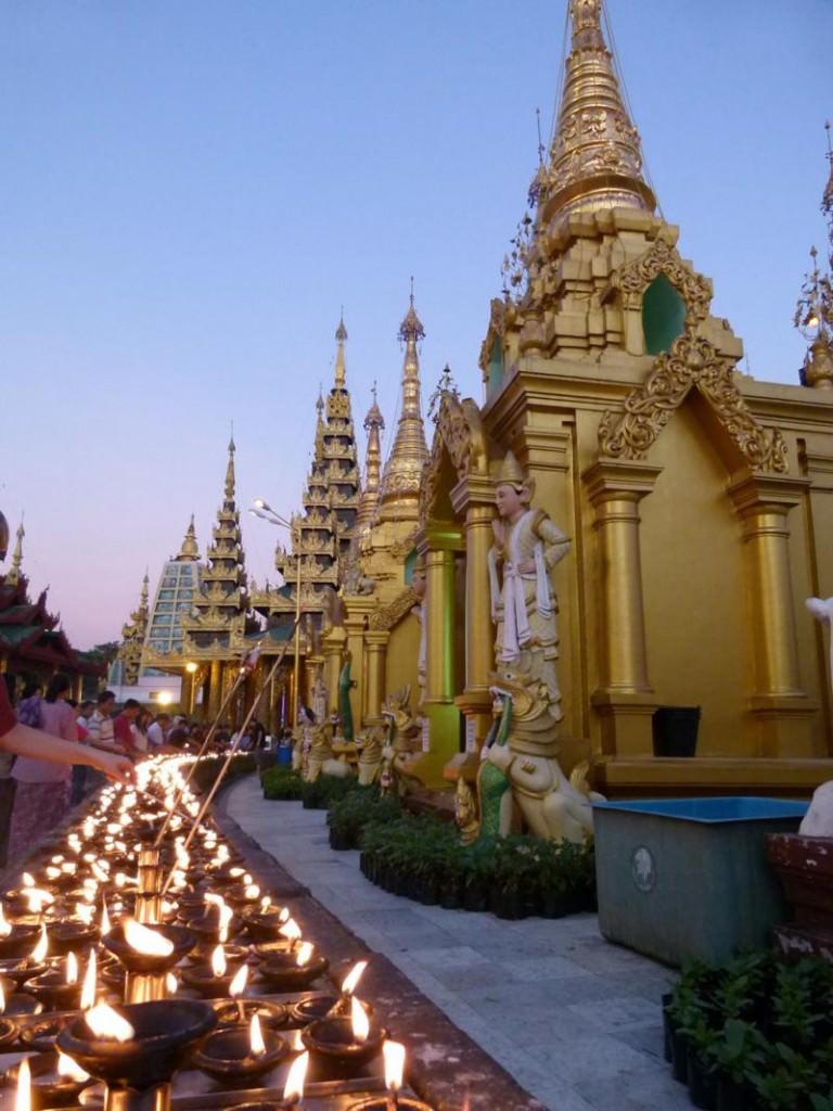 candles lit up at Shwedagon Paya in Yangon