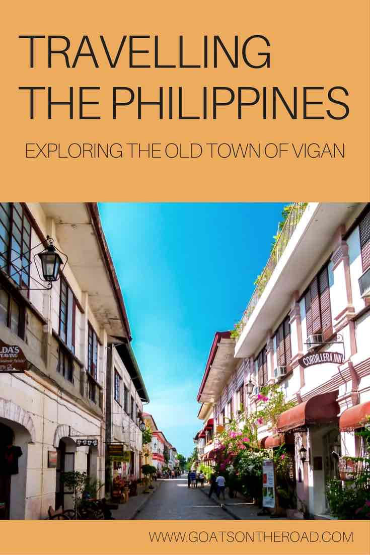 Main Street in Vigan Old Town with text overlay Travelling To The Philippines