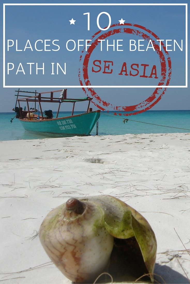 Shell on beach with boat and sea in background with text overly off the beaten path in SE Asia