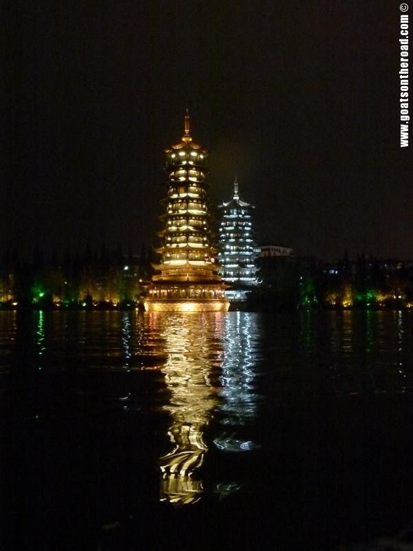 Beautiful Sun & Moon Pagodas lit up at night on the Shan Lake, Guilin, China