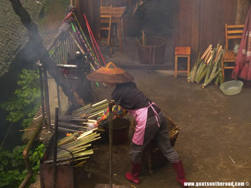 Village woman cooking rice in bamboo, Dragon's Backbone Rice Terraces, China
