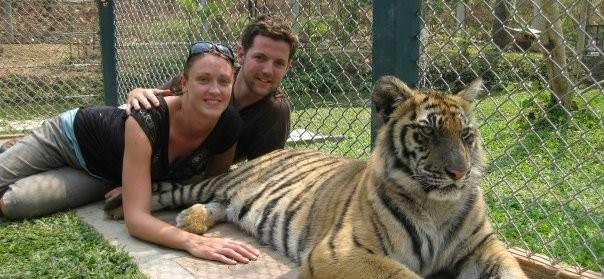 Laying With A Tiger In Chang Mai - backpacking thailand
