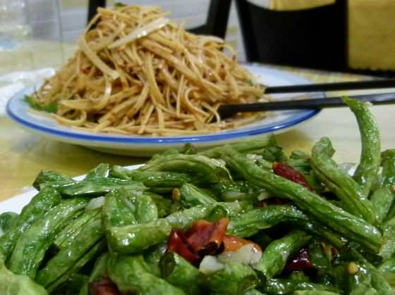 chinese food in china eating green beans and shredded tofu when backpacking china