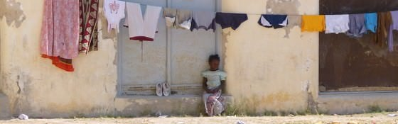 Mozambique Travel - A Girl In Front Of An Old Portugese House