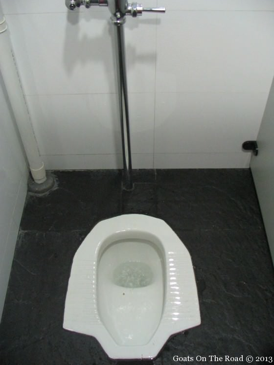 Backpackers use A Squat Toilet