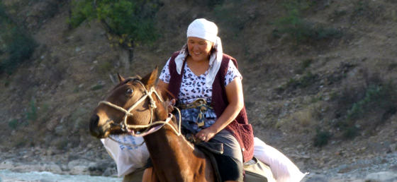 Kyrgyz Woman On A Horse