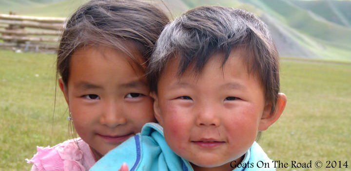 Mongolian Kids on the steppe traveling Mongolia