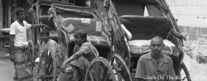 black and white rickshaw men india