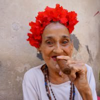 Woman Smokes Cigar in Havana, Cuba