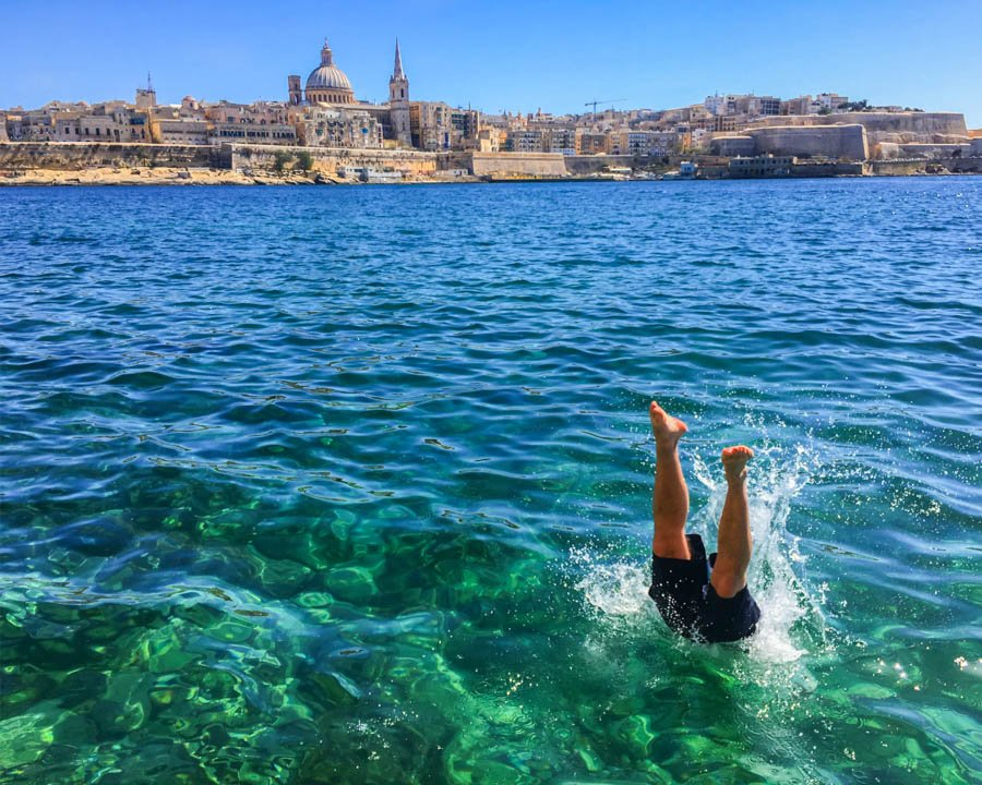 travel to malta valletta swimming in the mediterranean