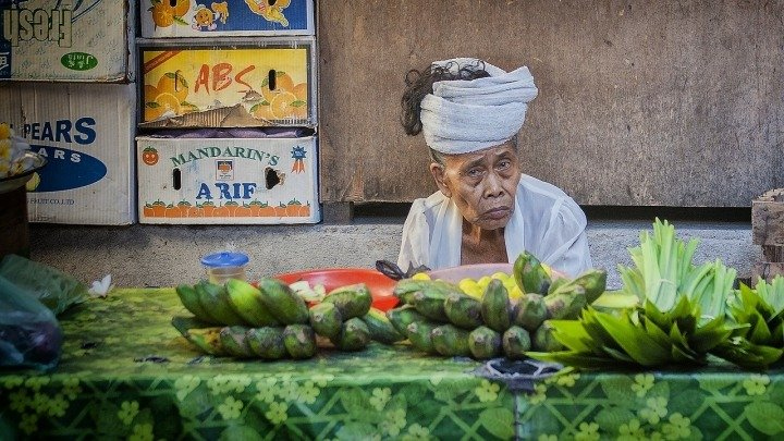 woman selling fruit at indonesian market