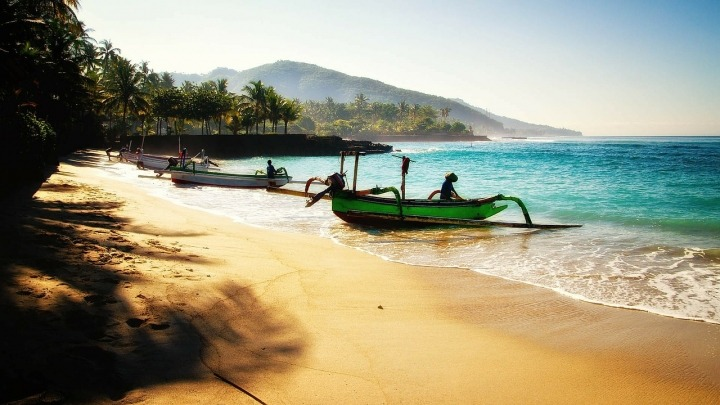 boat on the shore of a bali beach