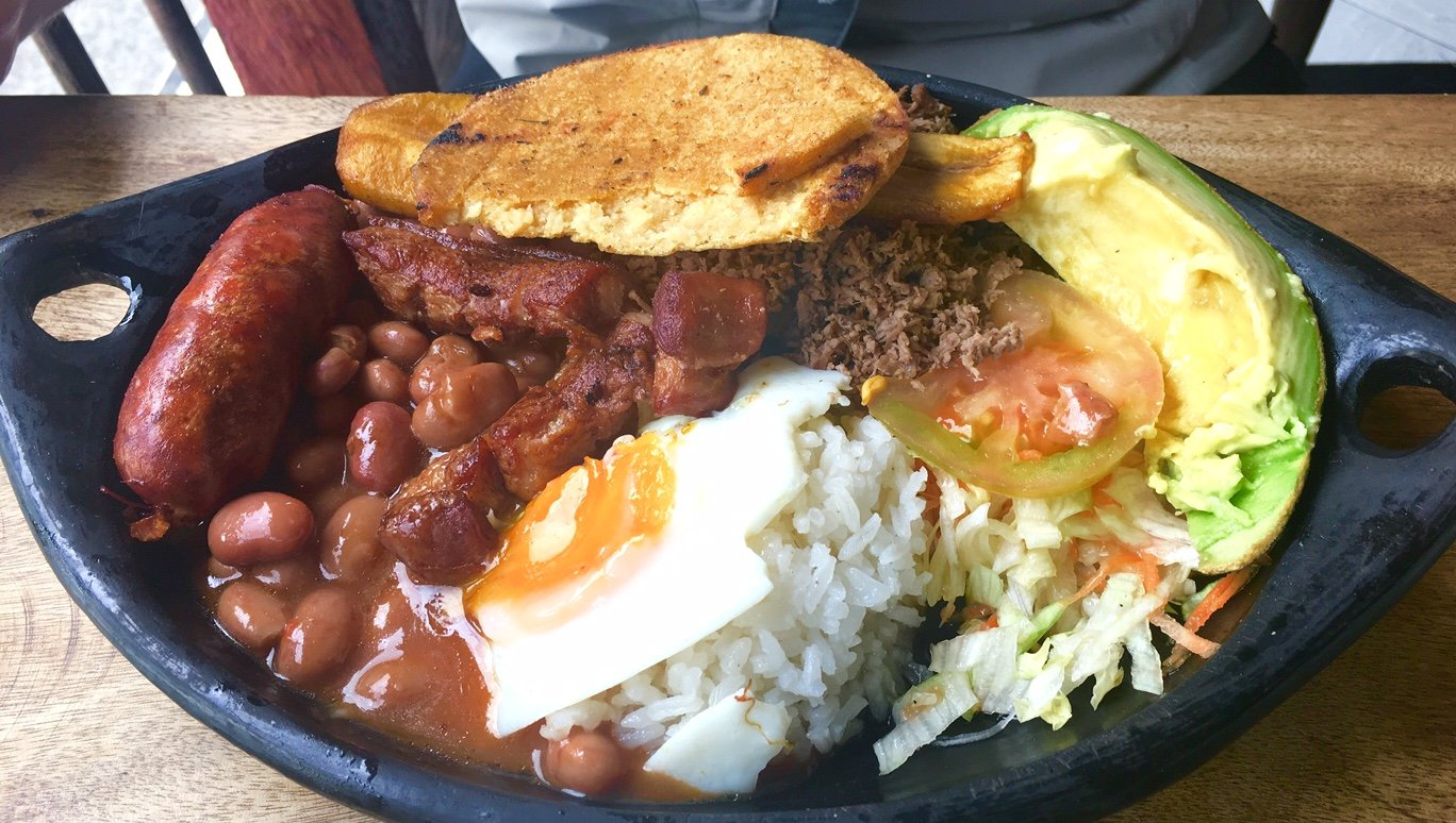 things to do in colombia eat bandeja paiasa
