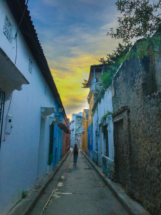 walking down a side alley in cartagena while travelling colombia