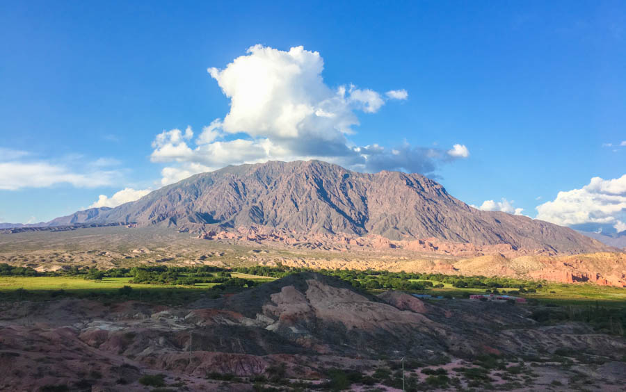 travel to cafayate argentina watch sunset from a mountain