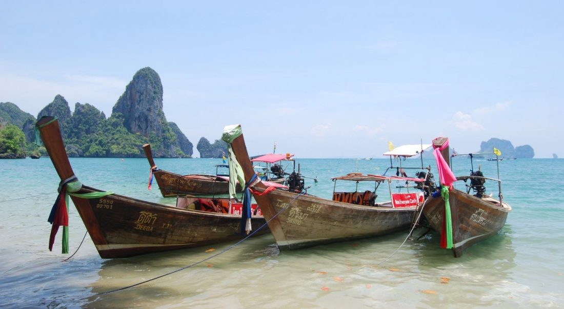 take a longtail boat when visiting thailand