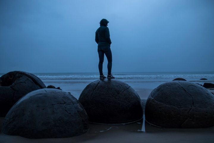 New Zealand Country Guide. A rainy morning at Moeraki Boulders. Photo by beardandcurly.com.