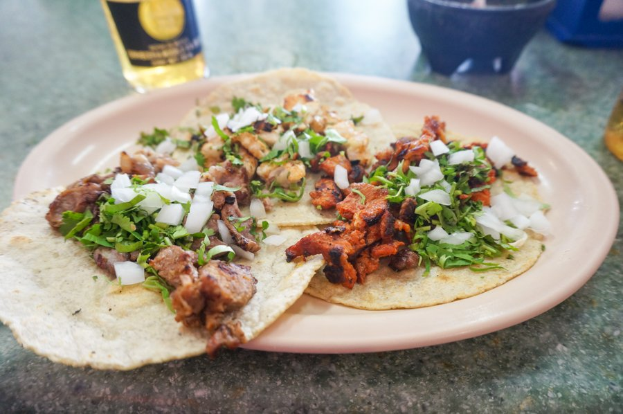 puerto vallarta is one of the best places to visit in mexico. don't miss the tacos and beer!
