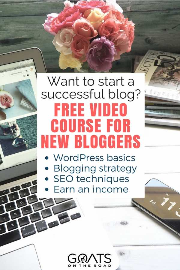 Laptop, flowers and phone on desk with text overlay free course for new bloggers