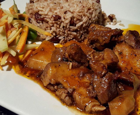 must try jamaican cuisine of Jamaican Stew Pork with Rice and Peas