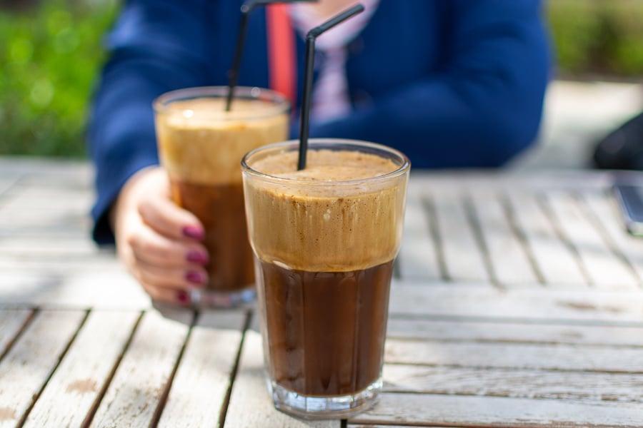 drinking freddo coffee in athens greece
