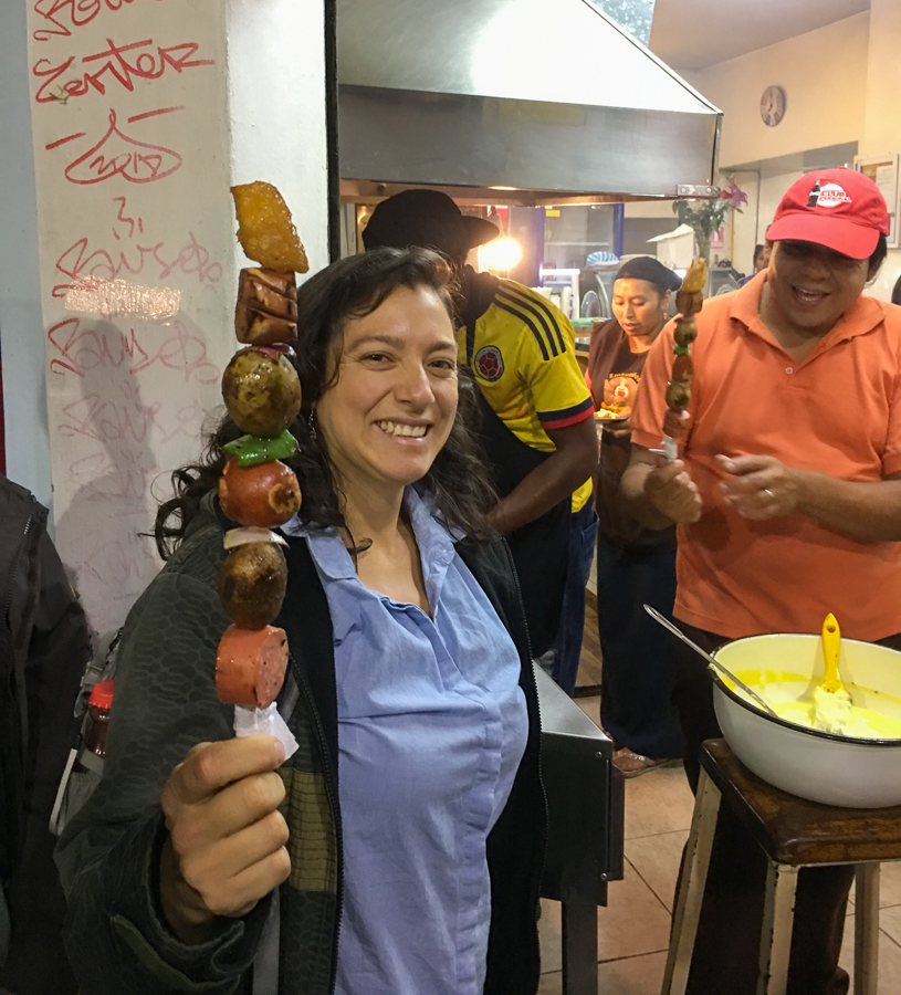 sampling different skewers on a food tour in quito