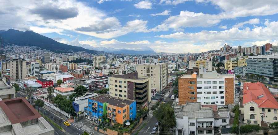 overlooking the new town in quito. buildings and mountains