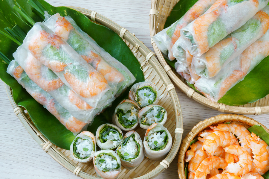 taking a cooking class in ho chi minh to learn to make shrimp rice rolls