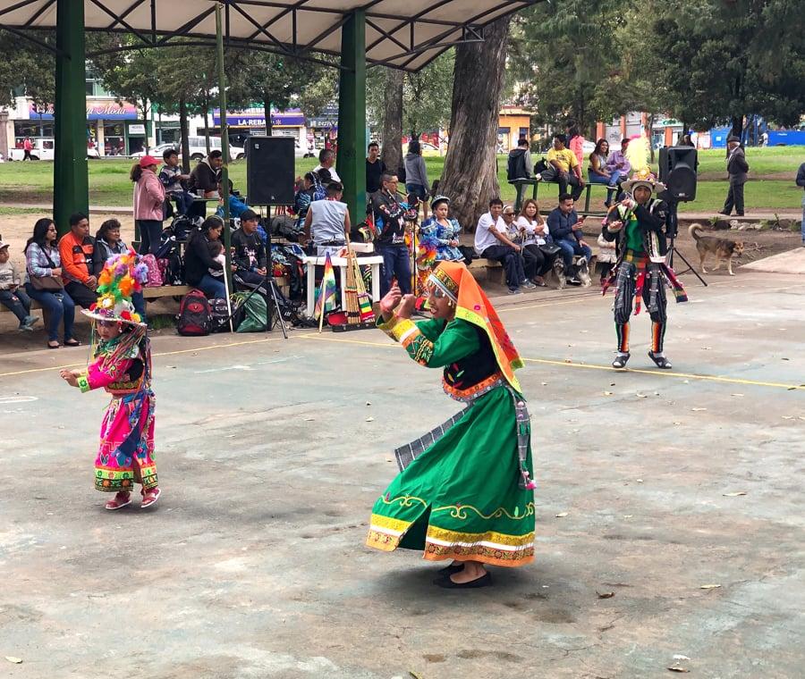a cultural dance performance in el ejido park quito