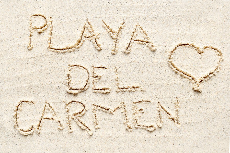 playa del carmen mexico written in the sand