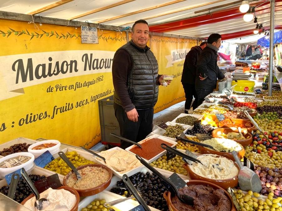 vendor at bastille market backpacker budget tips