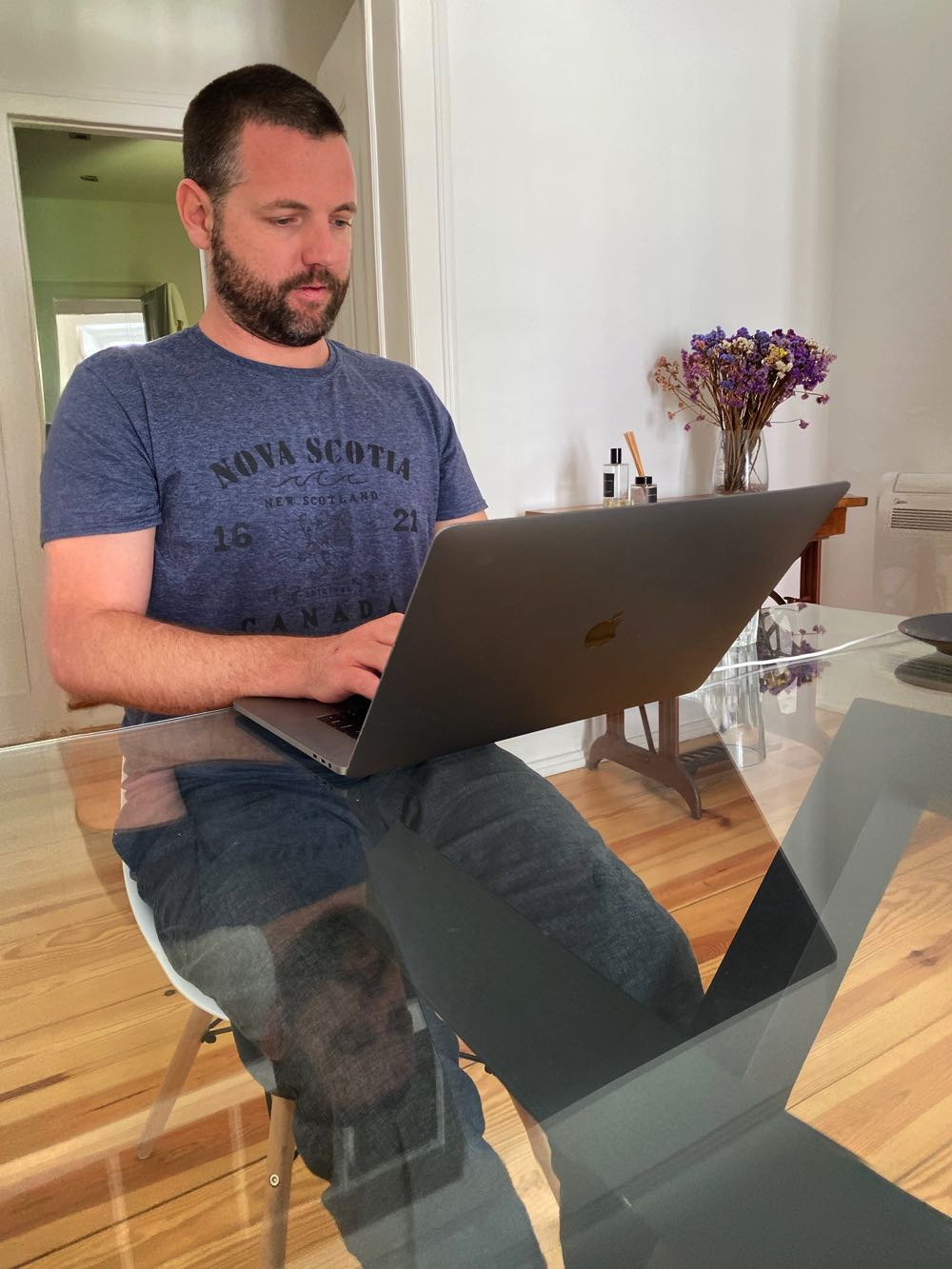 Me working on blogging on my laptop on website