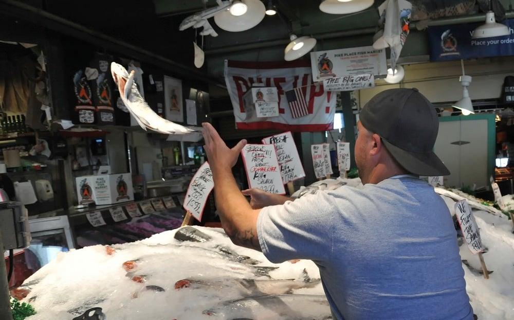 fish monger in seattle market