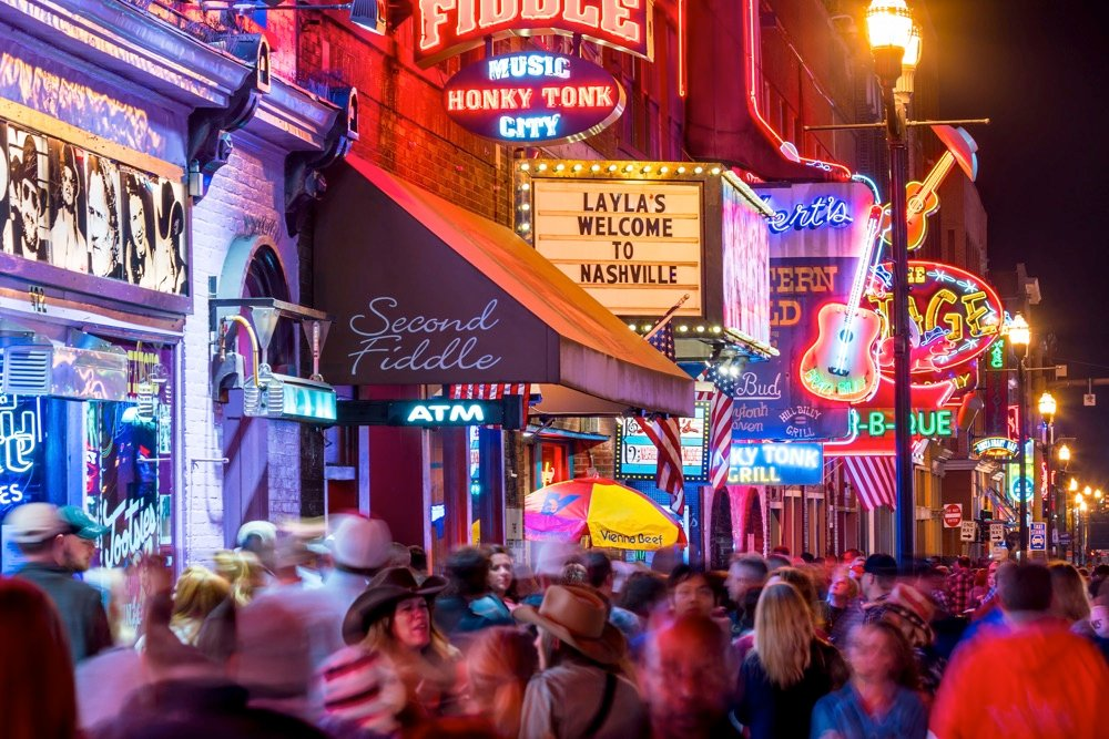 party on a weekend in nashville neon signs and people