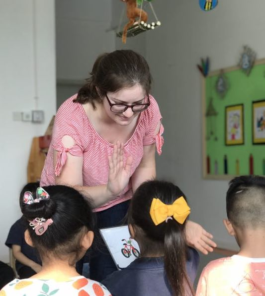 girl teaching students in china