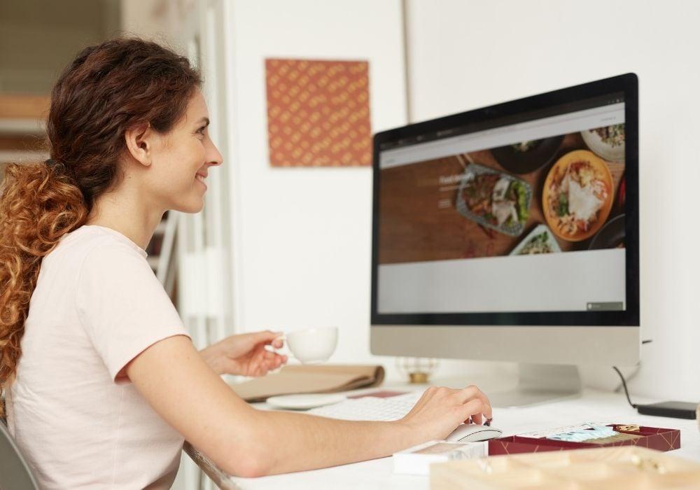 a web designer is working on her good website